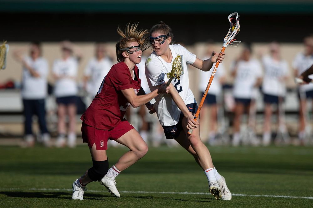 STANFORD, California - FEBRUARY 14:  Virginia Cavaliers midfield Sammy Mueller (2) is defended by Stanford Cardinal midfield Jacie Lemos (33) during the first half at Cagan Stadium on February 14, 2020 in Stanford, California. The Virginia Cavaliers defeated the Stanford Cardinal 12-11. (Photo by Jason O. Watson)