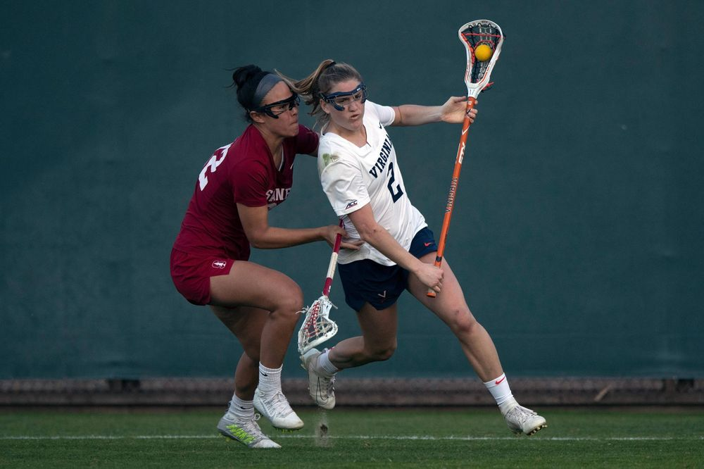 STANFORD, California - FEBRUARY 14: Virginia Cavaliers midfield Sammy Mueller (2) is defended by Stanford Cardinal midfield Daniella McMahon (32) during the second half at Cagan Stadium on February 14, 2020 in Stanford, California. The Virginia Cavaliers defeated the Stanford Cardinal 12-11. (Photo by Jason O. Watson)