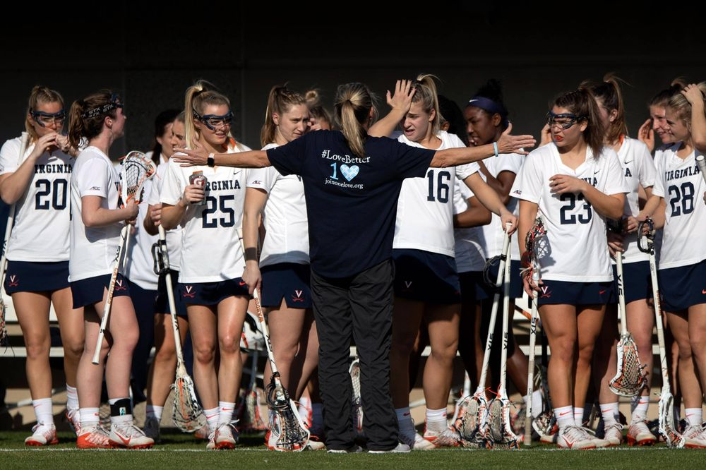 STANFORD, California - FEBRUARY 14:  Virginia Cavaliers head coach Julie Myers talks to her team before the game against the Stanford Cardinal at Cagan Stadium on February 14, 2020 in Stanford, California. The Virginia Cavaliers defeated the Stanford Cardinal 12-11. (Photo by Jason O. Watson)