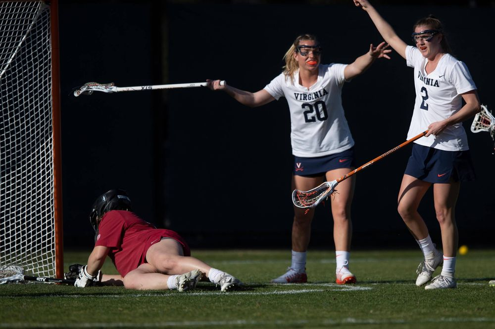 STANFORD, California - FEBRUARY 14:  Virginia Cavaliers midfield Sammy Mueller (2) celebrates with midfield Lillie Kloak (20) after scoring a goal past Stanford Cardinal goalkeeper Trudie Grattan (3) during the first half at Cagan Stadium on February 14, 2020 in Stanford, California. The Virginia Cavaliers defeated the Stanford Cardinal 12-11. (Photo by Jason O. Watson)