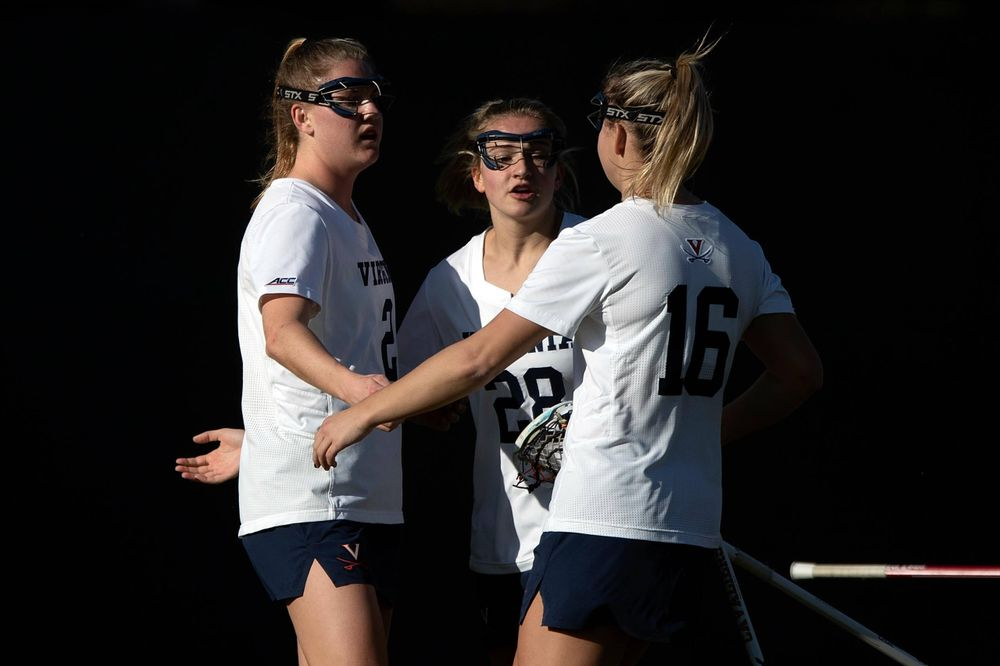 STANFORD, California - FEBRUARY 14:  Virginia Cavaliers midfield Sammy Mueller (2) is congratulated by midfield Nora Bowen (28) and midfield Ashlyn McGovern (16) after scoring a goal against the Stanford Cardinal during the first half at Cagan Stadium on February 14, 2020 in Stanford, California. The Virginia Cavaliers defeated the Stanford Cardinal 12-11. (Photo by Jason O. Watson)