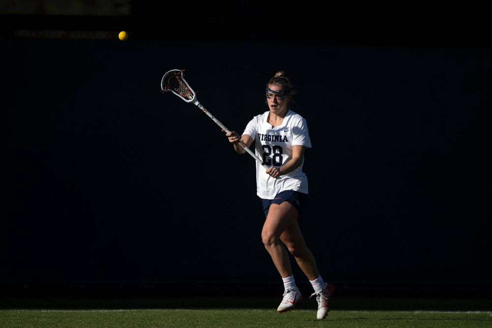 STANFORD, California - FEBRUARY 14:  Virginia Cavaliers midfield Nora Bowen (28) passes the ball against the Stanford Cardinal during the first half at Cagan Stadium on February 14, 2020 in Stanford, California. The Virginia Cavaliers defeated the Stanford Cardinal 12-11. (Photo by Jason O. Watson)