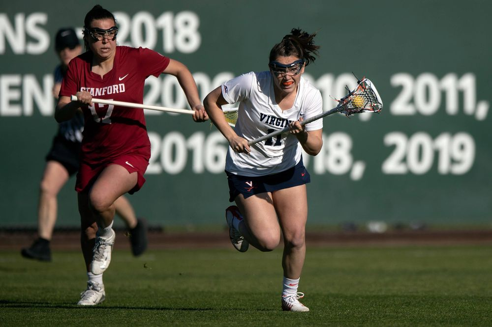 STANFORD, California - FEBRUARY 14:  Virginia Cavaliers midfield Halle Graham (11) runs up field past Stanford Cardinal attack Katherine Gjertsen (17) during the first half at Cagan Stadium on February 14, 2020 in Stanford, California. The Virginia Cavaliers defeated the Stanford Cardinal 12-11. (Photo by Jason O. Watson)