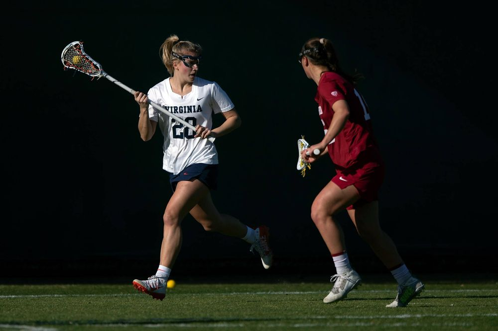STANFORD, California - FEBRUARY 14:  Virginia Cavaliers midfield Nora Bowen (28) carries the ball against the Stanford Cardinal during the first half at Cagan Stadium on February 14, 2020 in Stanford, California. The Virginia Cavaliers defeated the Stanford Cardinal 12-11. (Photo by Jason O. Watson)
