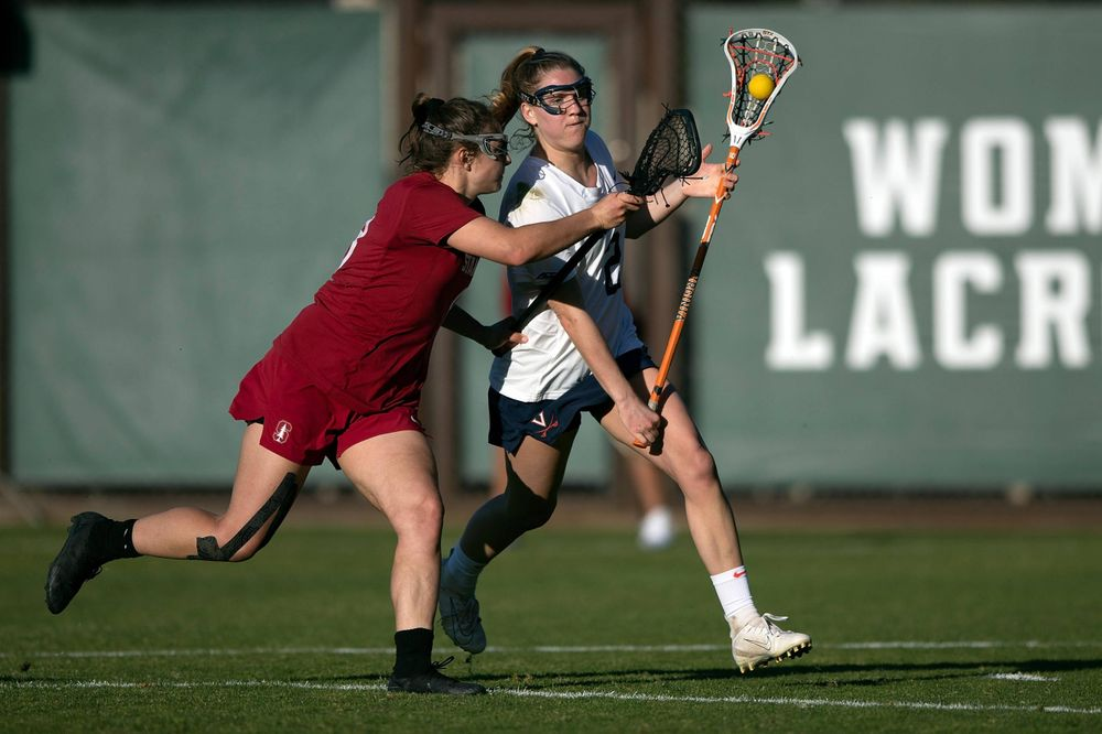 STANFORD, California - FEBRUARY 14:  Virginia Cavaliers midfield Sammy Mueller (2) is defended by Stanford Cardinal defense Kyra Pelton (8) during the second half at Cagan Stadium on February 14, 2020 in Stanford, California. The Virginia Cavaliers defeated the Stanford Cardinal 12-11. (Photo by Jason O. Watson)