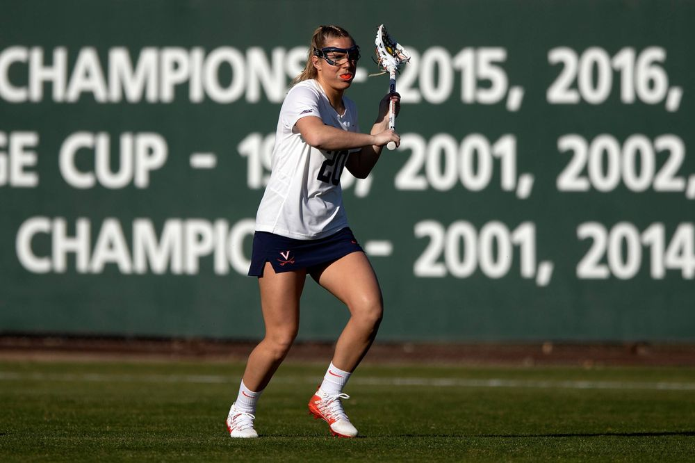 STANFORD, California - FEBRUARY 14:  Virginia Cavaliers midfield Lillie Kloak (20) passes the ball Stanford Cardinal during the first half at Cagan Stadium on February 14, 2020 in Stanford, California. The Virginia Cavaliers defeated the Stanford Cardinal 12-11. (Photo by Jason O. Watson)