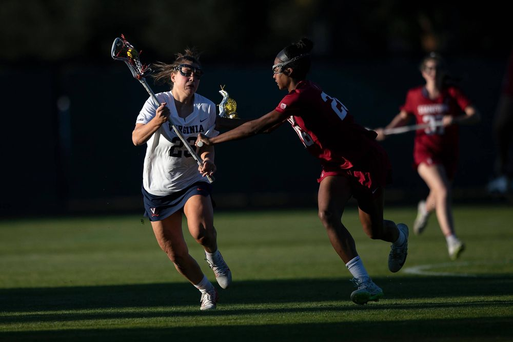 STANFORD, California - FEBRUARY 14: Virginia Cavaliers midfield Kiki Shaw (23) is defended by Stanford Cardinal midfield Mikaela Watson (26) during the second half at Cagan Stadium on February 14, 2020 in Stanford, California. The Virginia Cavaliers defeated the Stanford Cardinal 12-11. (Photo by Jason O. Watson)
