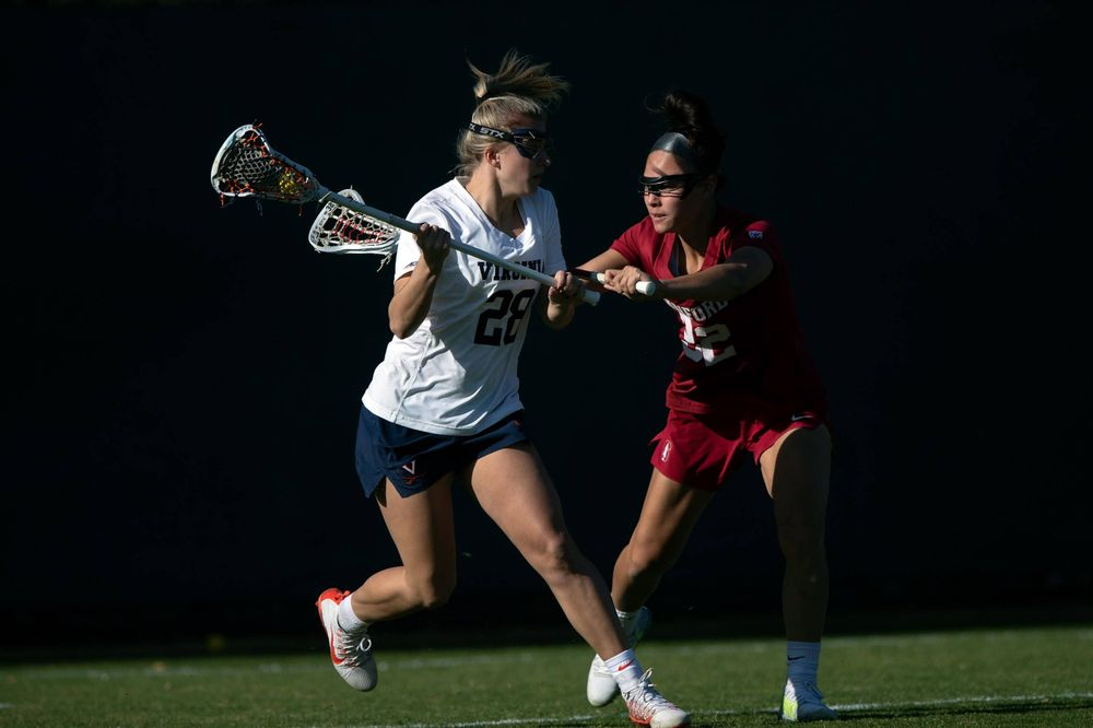 STANFORD, California - FEBRUARY 14:  Virginia Cavaliers midfield Nora Bowen (28) is defended by Stanford Cardinal midfield Daniella McMahon (32) during the first half at Cagan Stadium on February 14, 2020 in Stanford, California. The Virginia Cavaliers defeated the Stanford Cardinal 12-11. (Photo by Jason O. Watson)