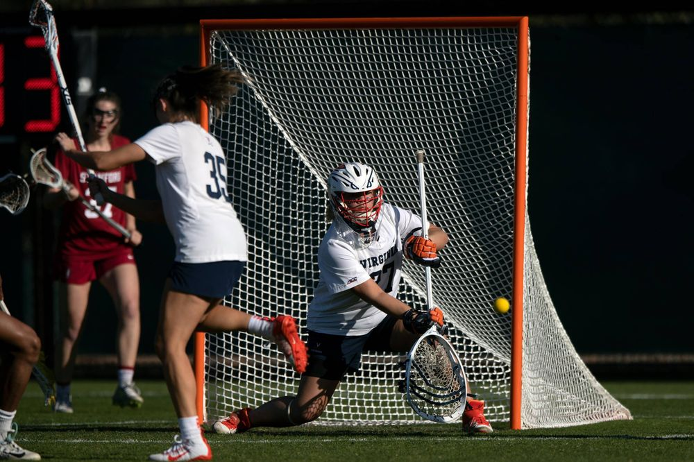 STANFORD, California - FEBRUARY 14:  Virginia Cavaliers goalkeeper Charlie Campbell (27) makes a save against the Stanford Cardinal during the first half at Cagan Stadium on February 14, 2020 in Stanford, California. The Virginia Cavaliers defeated the Stanford Cardinal 12-11. (Photo by Jason O. Watson)