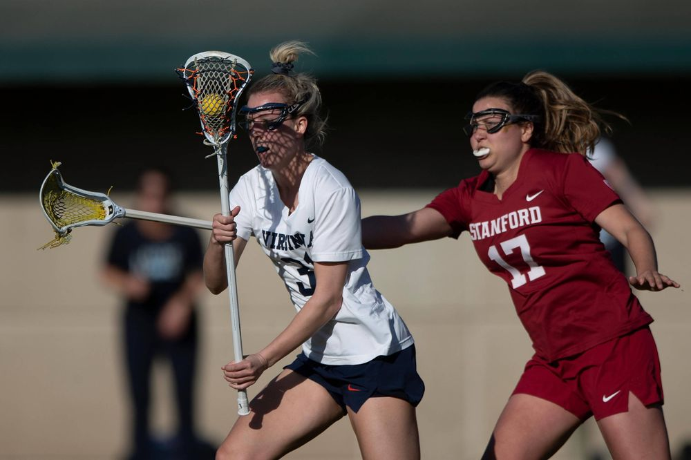 STANFORD, California - FEBRUARY 14:  Virginia Cavaliers defense Ashley Stilo (31) is defended by Stanford Cardinal attack Katherine Gjertsen (17) during the first half at Cagan Stadium on February 14, 2020 in Stanford, California. The Virginia Cavaliers defeated the Stanford Cardinal 12-11. (Photo by Jason O. Watson)