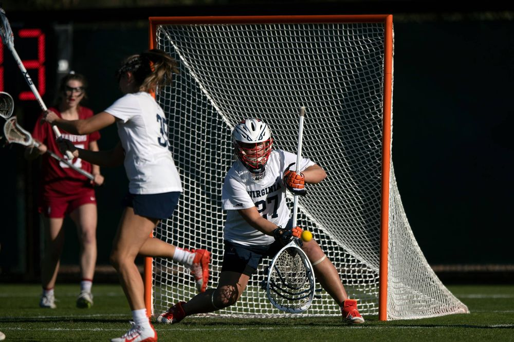 STANFORD, California - FEBRUARY 14:  Virginia Cavaliers goalkeeper Charlie Campbell (27) saves a shot against the Stanford Cardinal during the first half at Cagan Stadium on February 14, 2020 in Stanford, California. The Virginia Cavaliers defeated the Stanford Cardinal 12-11. (Photo by Jason O. Watson)
